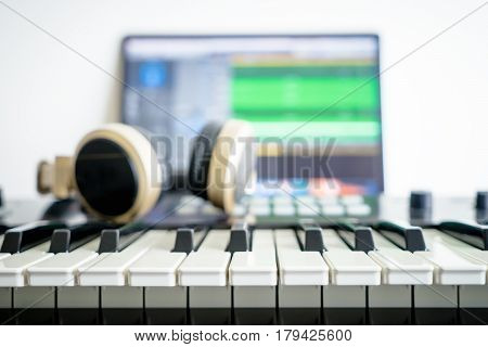 Music keyboard and Music mixing headphone on computer music station poster