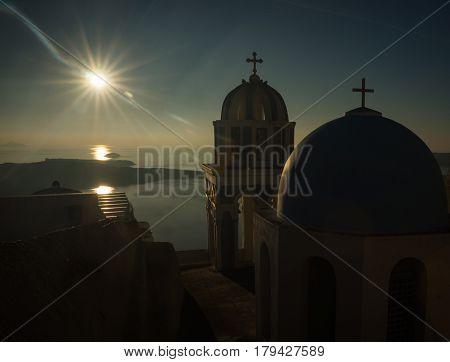 Sunset over the sea and churches, Santorini island, Greece