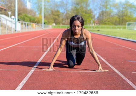 Woman Doing Sprint Training On A Sports Track
