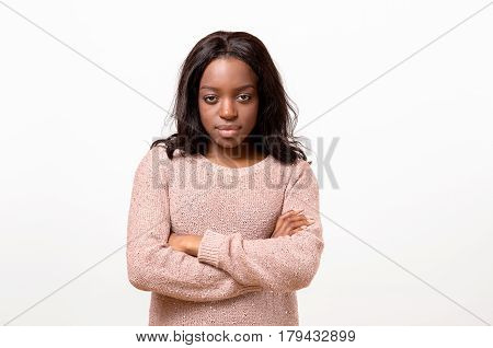 Serious Young Woman Standing With Folded Arms
