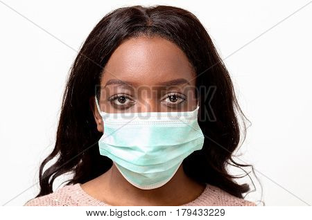Young African Woman Wearing A Surgical Face Mask