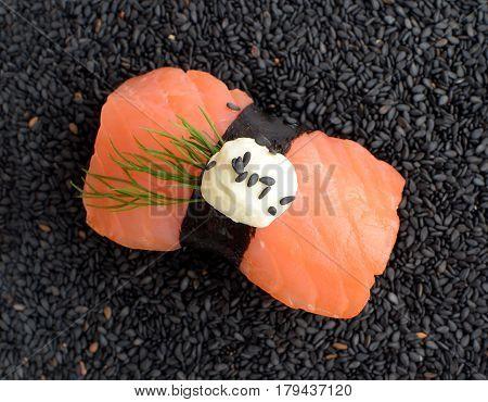 Nigiri Sushi With Salmon And Seaweed Nori On Dark Background