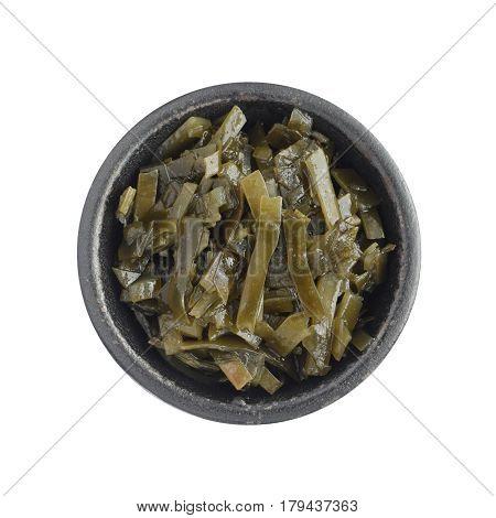 Dark Green Seaweed Salad In Black Bowl Isolated
