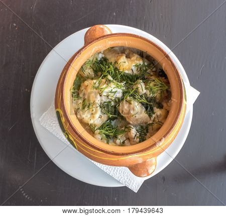 Meat Stewed in a Clay Pot with Potatoes and Dill Top View