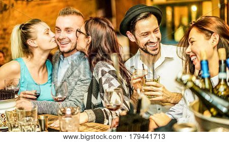 Fashion trendy friends drinking cocktails and wine in bar winery shop - Young students having party in night club - Fun and friendship concept - Focus on right man face - Unfiltered photo with flash