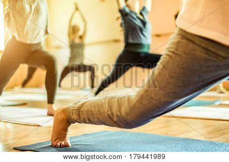 Group of old and young women doing yoga in Vipassana meditation school centre - Spiritual concept for healthy and relax lifestyle - Focus on female bottom foot - Warm contrast filter