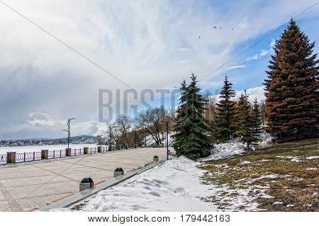 View of quay wharf embankment Ural Nizhny Tagil City. Winter.