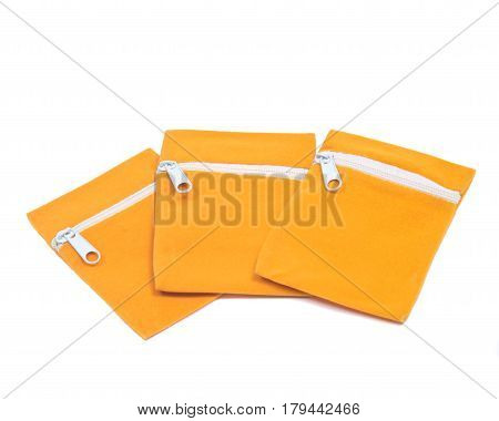 Colorful velveteen crystal pouches with zipper isolated on white background