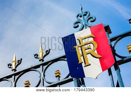 Paris France - March 27 2017: Gate with golden decoration and french flag. Predidential elections concept