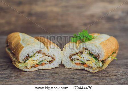 A Delicious Vietnamese Bahn Mi Sandwich On A Wooden Background