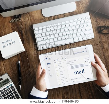 Hands composing an email on a digital device