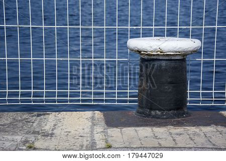 Photo of a bollard with selective focus and sunlight