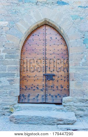 particular of woden door brown  of a castle with a series of iron nails and its clapper / FENIS,ITALIA-5 SEPTEMBER . Entrance to the courtyard of the  castle of  Fenis  in Aosta Valley on September 5 2016,in Fenis