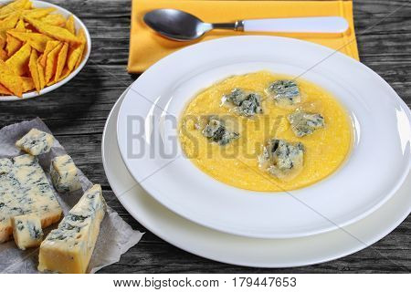 Polenta With Gorgonzola In White Plate