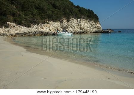 Panoramic view of a white sandy beach, sea and cliffs, Paxi island, Greece