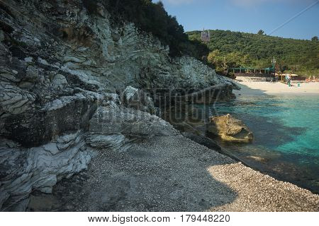 Scenic view of a beach with sea and cliffs, Paxi island, Greece