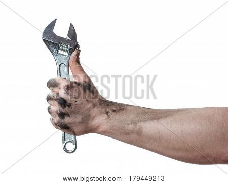 Oily hands of mechanic holding a wrench. Isolated background.