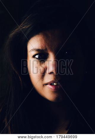 Dark and moody portrait of asian woman