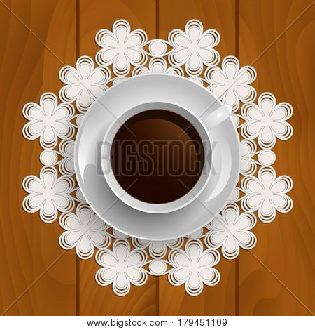 Cup of coffee on lace napkin on a wooden background. Top view.