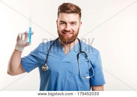 Portrait of a smiling happy medical doctor or nurse holding syringe and looking at camera isolated on white background