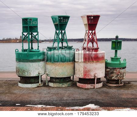 Navigational buoys docked on the shore of The Saint Lawrence River