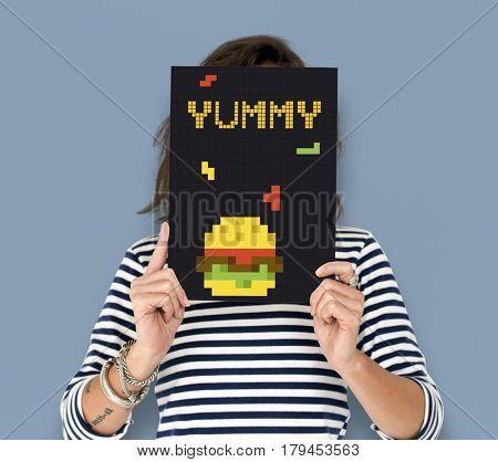 Woman holding banner of 8 bit illustration of tasty burger meal
