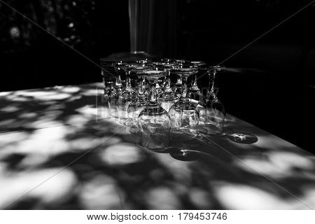 Inverted glasses on the table. Black and white photo