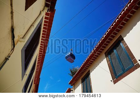 Cable Ropeway Cabin Over The Roofs Of Buildings In Funchal, Madeira Island