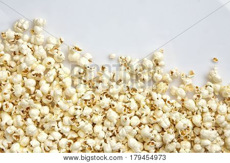 Tasty salted popcorn isolated on white background