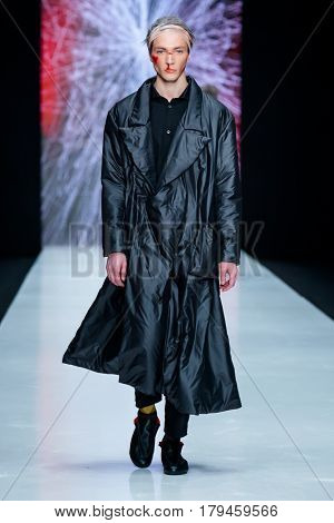 MOSCOW RUSSIA - MARCH 16 2017: Model walk runway for ARTEM SHUMOV catwalk at Fall-Winter 2017-2018 at Mercedes-Benz Fashion Week Russia. Men's fashion.