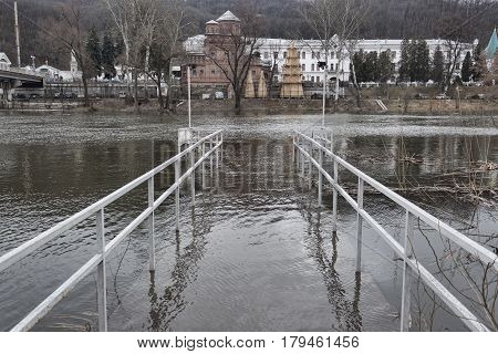 The bridge at the river flooded with spilled water