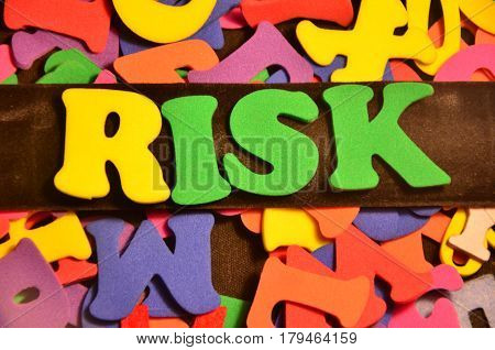 word risk on a  absbtract colorful background
