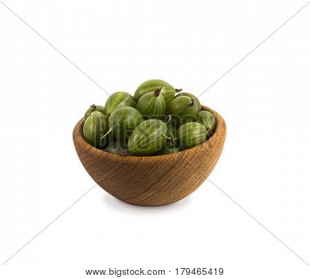 Gooseberries fruits isolated on white background. Gooseberries in a wooden bowl with copy space for text. Ripe gooseberry close-up. Background berry. Sweet and juicy berry.