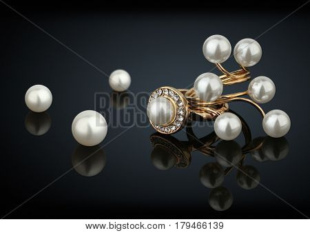 Golden rings with diamonds and pearls on black