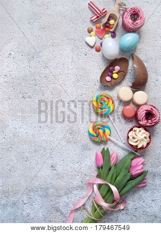 Assorted easter sweets bakery cupcakes chocolate eggs and confectionery
