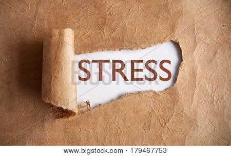 Torn piece of scroll uncovering the word stress