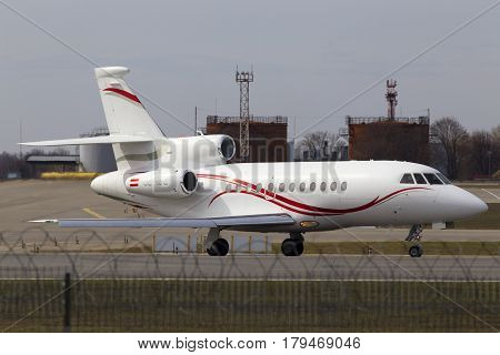 Borispol, Ukraine - March 25, 2017: Dassault Falcon 900EX aircraft preparing for take-off from the runway of Borispol International Airport on March 25, 2017. Editorial use only