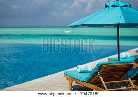 A soft blue chaise lounge in Maldivian resort