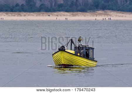 FISHING BOAT - Yellow boat on the Pomeranian bay