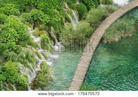 Aerial view overlooking a timber walkway and waterfalls in the beautiful Plitvice Lakes National Park in Croatia.