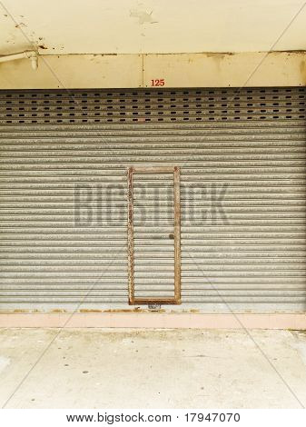 old and rusty iron grill entrance