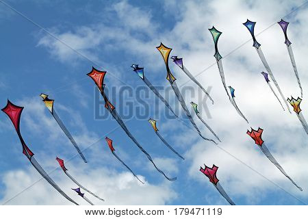 Colorful Kites Flying in a Cloudy Summer Sky