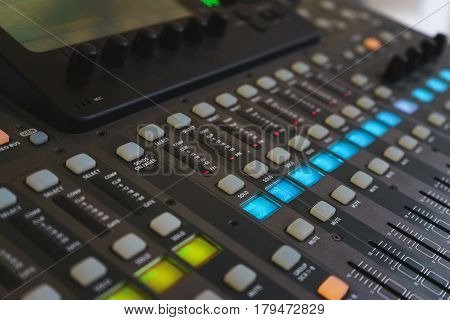 Music equipment closeup. Management console sound design at the event. Big black mixer with control knobs. Electronics and modern technology.