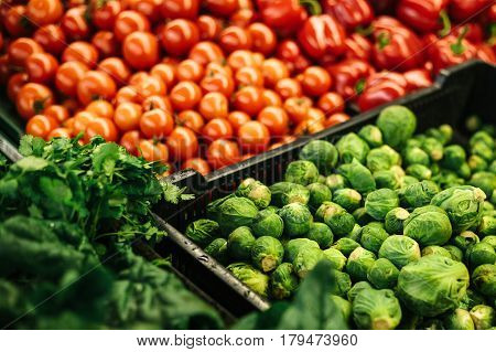 Many different vegetables on the farmers market. Brussels sprouts, cabbage, tomatoes, peppers, lettuce. Natural local products on the farm market. Harvest. Seasonal products. Food. Vegetables mix.