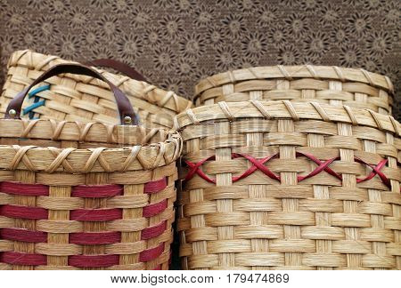 Several Handwoven Tan and Red Wooden Baskets