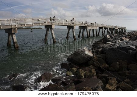 Rocks along the breakwater and the fishing pier in Jetty Park near Cocoa, Florida