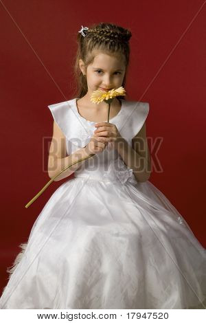 little smiling girl with flower