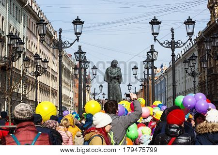 Saint-Petersburg, Russia - April 1, 2017: Procession of Funny festival XVI in Petersburg near Nikolaj Gogol monument