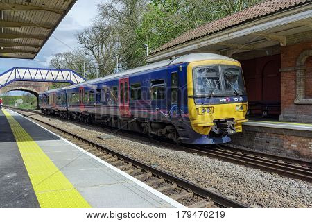 Mortimer, UK. 1st April 2017. A diesel multiple unit class 165 has arrived at Mortimer station which is served by trains between Basingstoke and Reading.