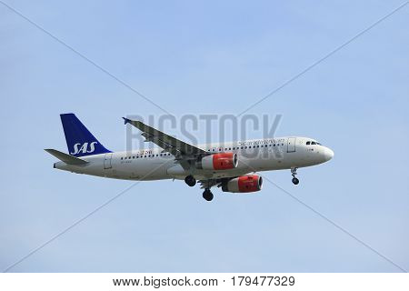 Amsterdam the Netherlands - March 31st 2017: OY-KAU SAS Scandinavian Airlines Airbus A320-200 approaching Polderbaan runway at Schiphol Amsterdam Airport the Netherlands